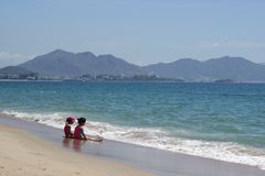 Nha Trang, Viet Nam - July 12, 2015: Children plays on the beach stock photography