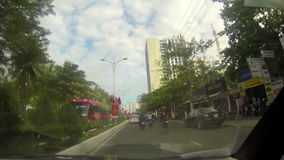 NHA TRANG, VIETNAM - APRIL 27, 2015: traffic and people in downtown district stock video
