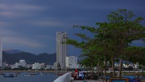Asian holiday resort Nha Trang Vietnam HD Panoramic. Nha Trang, Vietnam, Asia July 3 2018. Vietnamese holiday resort beach front skyline scene with colourful stock video footage