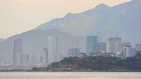 Asian Vacation Resort Nha Trang Vietnam HD Panoramic. Nha Trang, Vietnam, Asia July 3 2018. Vietnamese holiday resort beach front skyline scene with colourful stock video footage