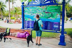 NHA TRANG,VIETNAM - FEBRUARY 17,2018: Young man traveling and looking at the travel map. Beside the sleeping royalty free stock photo