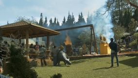 Buddhist Temple People Burn Wood in Ritual Vats. NHA TRANG/VIETNAM - JANUARY 06 2018: Traditional Buddhist temple yard people burn wood in ritual vats and stock footage