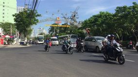Nha Trang, Vietnam - 10 March, 2017. Asia city crossroad timelapse fast. Many cars and motorcycles are moving chaotically without rules. Summer day on street stock video