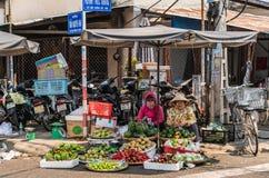 Two women sell freshly harvested fruits on corner, Nha Trang, Vietnam