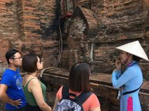 Vietnamese tour guide at work royalty free stock image