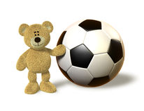 Nhi Bear next to a huge Soccer Ball Royalty Free Stock Images