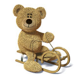 Nhi Bear on the sledge. Nhi Bear smiles and rides a sledge Stock Photo