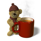 Nhi Bear with a steaming mug of tea. Royalty Free Stock Photos