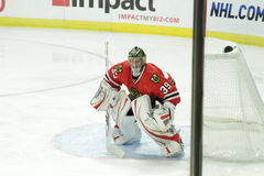 NHL Chicago Blackhawk Goalie. Image of the professional hockey game in progress, Chicago Blackhawk goalie, Huet as he protects the goal from rival team Stock Images