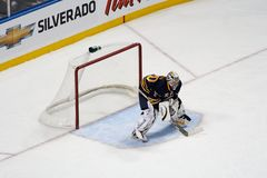 NHL Goaltender Ryan Miller guards the net. Ryan Miller, goalie for the Buffalo Sabres hockey team and 2010 US Winter Olympic hockey team goaltender and Stock Photos