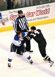 NHL Hockey Game Fight. Jamie Benn and Erik Johnson fight while a referee watches Stock Image