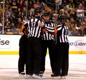 NHL referees and linesmen. National Hockey League referees and linesmen gather at center ice before game-time Royalty Free Stock Images