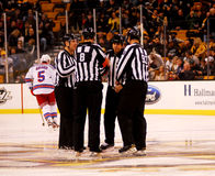NHL Referees and linesmen at center ice. Referees: Dave Jackson, Tom KowalrnLinesmen: Brian Murphy, Scott Cherrey gather at center ice before the New York Stock Image