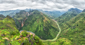 Nho Que river valley on the rocky plateau of Ha Giang. Followed hills covered with green grass and cloud cover make nature more majestic than Royalty Free Stock Photography
