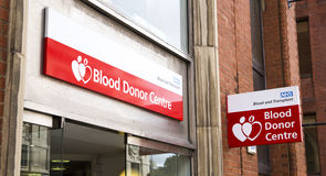NHS blodgivaremitten Arkivbild