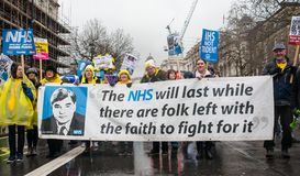 The NHS In Crisis demonstration, through central London, in protest of underfunding and privatisation in the NHS. London, England. 3rd February 2018. EDITORIAL Royalty Free Stock Image