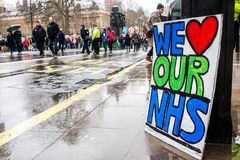 The NHS In Crisis demonstration, through central London, in protest of underfunding and privatisation in the NHS. London, England. 3rd February 2018. EDITORIAL Stock Images