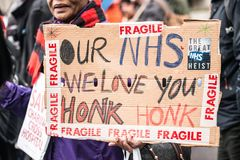 The NHS In Crisis demonstration, through central London, in protest of underfunding and privatisation in the NHS. London, England. 3rd February 2018. EDITORIAL Stock Photo