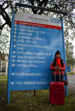 NHS Health Tourism. Photo of a Filipino woman with suitcase, backpack, passport and toothbrush at Rotherham NHS Hospital Royalty Free Stock Image