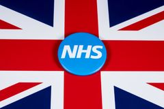 NHS Logo on the UK Flag. LONDON, UK - APRIL 27TH 2018: The National Health Service symbol over the UK flag, on 27th April 2018.  The NHS was established in 1948 Stock Photo