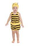 Niña adorable en un traje rayado de la abeja Foto de archivo