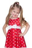 Niña adorable en un vestido rojo Imagen de archivo