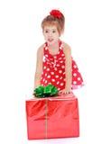 Niña adorable en un vestido rojo con blanco Imagen de archivo libre de regalías