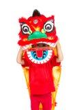 Niña asiática en chino Lion Custome Dance During Chinese N Imagen de archivo libre de regalías