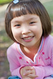 Niña asiática sonriente fotos de archivo