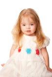Niña bonita con el pelo rubio y los ojos azules Foto de archivo