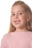 Niña bonita con los dientes feos verticales Foto de archivo libre de regalías