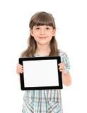 Niña bonita con un ordenador de la tableta Fotos de archivo