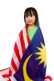 Niña china asiática con la bandera de Malasia Fotos de archivo
