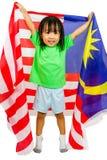Niña china asiática con la bandera de Malasia Imagen de archivo