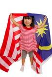 Niña china asiática con la bandera de Malasia Imágenes de archivo libres de regalías