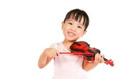 Niña china que toca el violín Fotografía de archivo libre de regalías