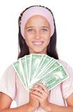 Niña con con con las cuentas de dólar Foto de archivo libre de regalías