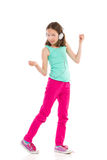Niña con el baile de los auriculares Imagenes de archivo