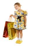 Niña con el bolso de compras. Fotos de archivo libres de regalías