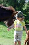 Niña con el burro Imagen de archivo libre de regalías