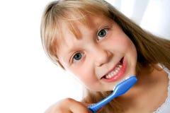 Niña con el cepillo Foto de archivo libre de regalías