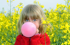 Niña con el globo Fotos de archivo