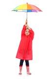 Niña con el paraguas. foto de archivo
