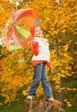 Niña con el paraguas Foto de archivo