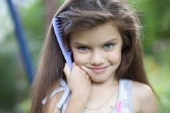Niña con el pelo hermoso Foto de archivo libre de regalías