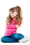 Niña con el pelo largo en una blusa rosada fotografía de archivo libre de regalías