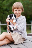 Niña con el perrito Imagen de archivo