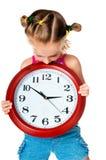 Niña con el reloj Foto de archivo libre de regalías