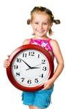Niña con el reloj Foto de archivo