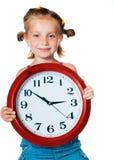 Niña con el reloj Fotos de archivo